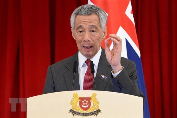 Singaporean PM urges Australia, NZ to work with ASEAN in easing travel restrictions hinh anh 1