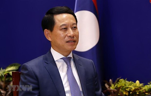Laos applauds Vietnam's contributions to enhancing ASEAN's role hinh anh 1