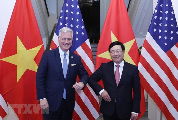 Deputy PM Pham Binh Minh holds talks with US Security Advisor hinh anh 1