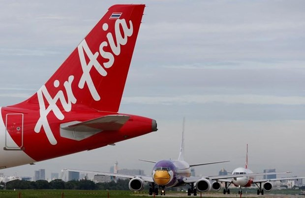 Net loss of Malaysia's AirAsia Group grows in Q3 hinh anh 1