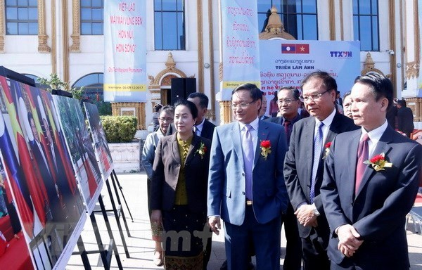 Photo exhibition celebrates Lao National Day hinh anh 1