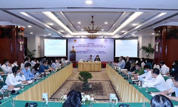 HCM City conference discusses implementation of global compact for migration hinh anh 1