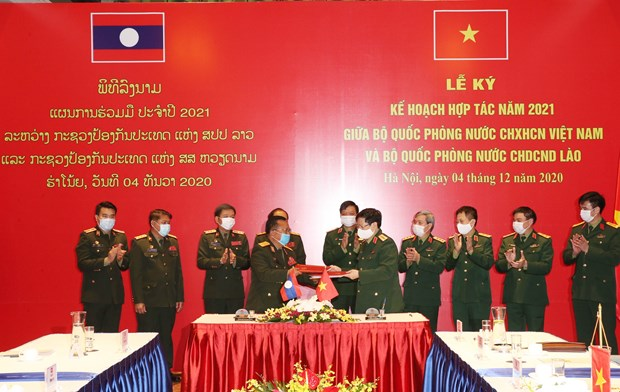 Vietnamese, Lao defence ministries ink cooperation plan for 2021 hinh anh 1