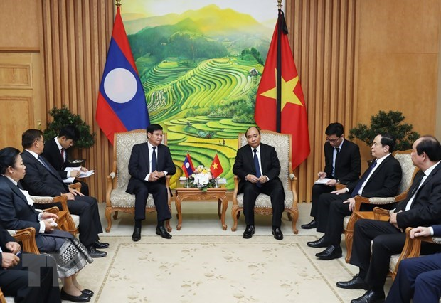 Vietnam, Laos determined to foster comprehensive cooperation hinh anh 1