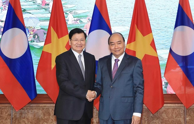 Lao PM visits Vietnam, co-chairs inter-governmental committee's session hinh anh 1