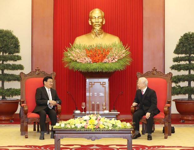 Party, State leader receives visiting Laos PM hinh anh 1