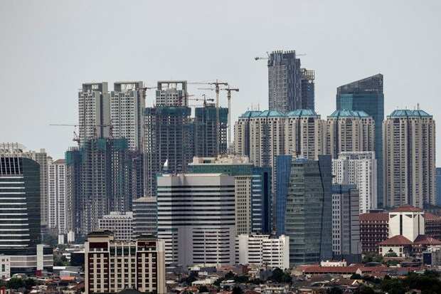 ADB lowers growth forecasts for Indonesian economy hinh anh 1