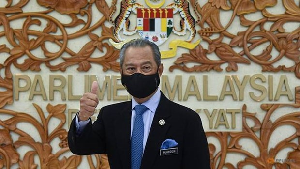 Malaysia declares COVID-19 emergency state hinh anh 1