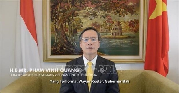 Photo exhibition underway in Bali to mark 65th anniversary of Vietnam-Indonesia ties hinh anh 3