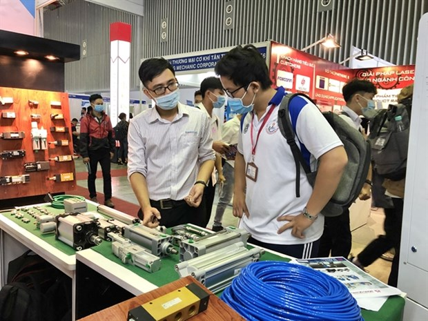 International machinery, supporting industry fairs open in HCM City hinh anh 1