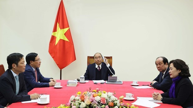 Prime Minister holds phone talks with US President hinh anh 2