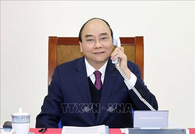 Prime Minister holds phone talks with US President hinh anh 1