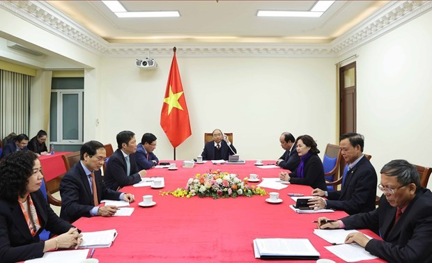 Prime Minister holds phone talks with US President hinh anh 3