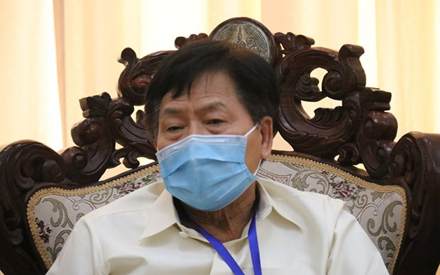 Lao gov't urges people to continue COVID-19 prevention measures hinh anh 1