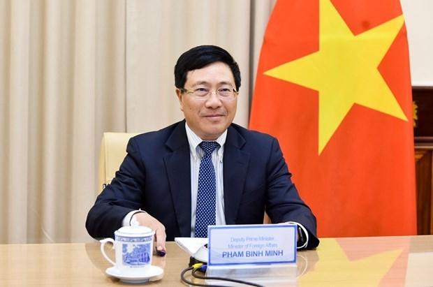 Deputy PM praises int'l integration results in politics, security, defence hinh anh 1