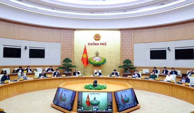 Government's December meeting scrutinises policy, law making hinh anh 1