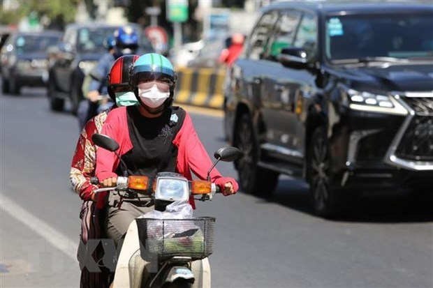 COVID-19: Cambodia relaxes restrictions, Singapore, Indonesia promotes vaccination plans hinh anh 1
