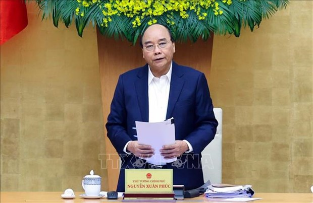 Prime Minister request reviewing COVID-19 prevention measures, scenarios hinh anh 1