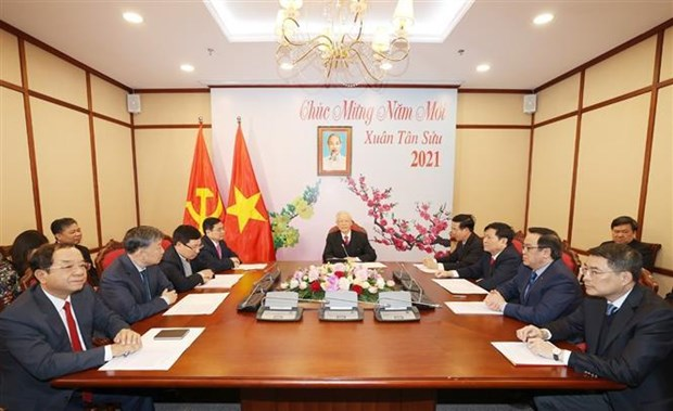 Top leader holds phone talks with new Secretary General of Lao People's Revolutionary Party hinh anh 2