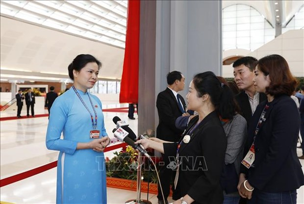 Delegates highlight trade union, women support issues at 13th National Party Congress hinh anh 2