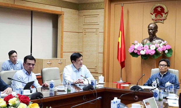 Health ministry takes action following confirmation of two community COVID-19 cases hinh anh 2