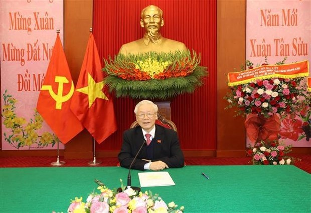 Vietnamese, Lao Party chiefs hold phone talks hinh anh 1