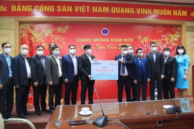 Health Ministry receives 21 billion VND in donation to vaccine purchase fund hinh anh 1