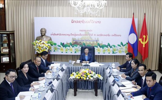 Outcomes of Lao People's Revolutionary Party's 11th National Congress informed to Vietnam hinh anh 1