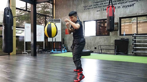 Vietnamese boxer gears up for world title shot hinh anh 1