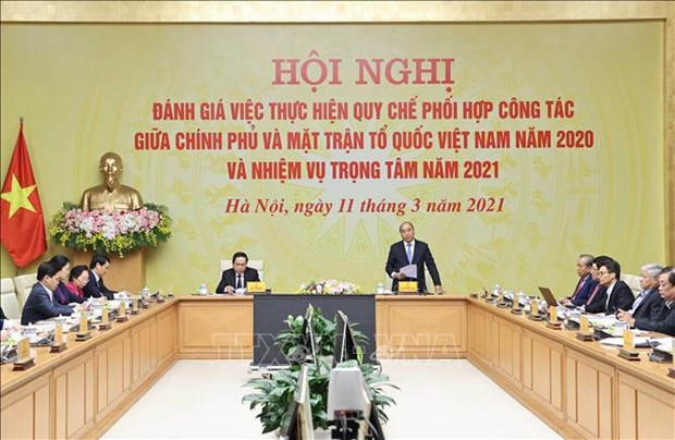 PM hails effective Gov't-VFF coordination in COVID-19 relief efforts in 2020 hinh anh 1