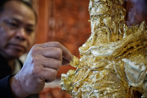 Gold laminating and gilding in Kieu Ky village recognised as national heritage hinh anh 1