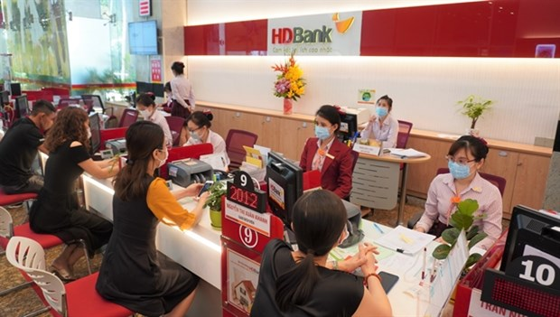 HDBank raises working capital, earmarks credit package for customers hit by COVID-19 hinh anh 1