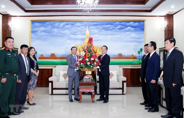 Vietnam congratulates Lao Party on 66th founding anniversary hinh anh 1