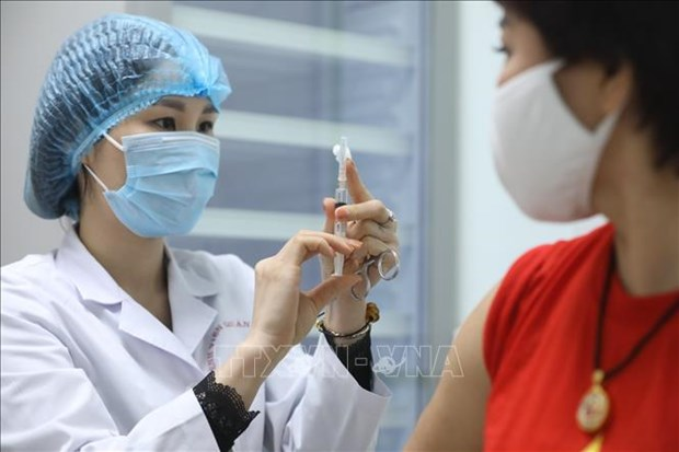 Volunteers get 2nd shot of Nano Covax vaccine in second trial phase hinh anh 1