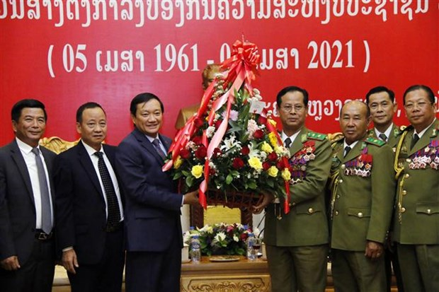 Greetings conveyed to Lao Public Security force on 60th founding anniversary hinh anh 1