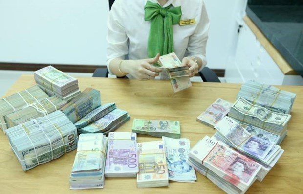 Reference exchange rate down 8 VND on April 8 hinh anh 1