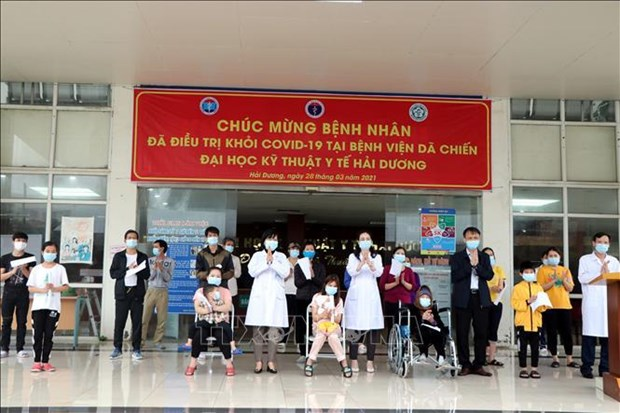 Only nine COVID-19 patients remain under treatment in Hai Duong hinh anh 1