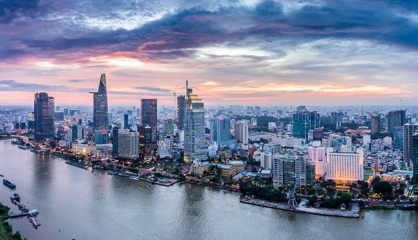 COVID-19 containment contributes to Vietnam's upgraded outlook: Fitch Ratings hinh anh 1