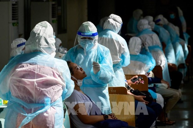 Thailand sees new daily record of COVID-19 deaths, Singapore probing re-infections hinh anh 1
