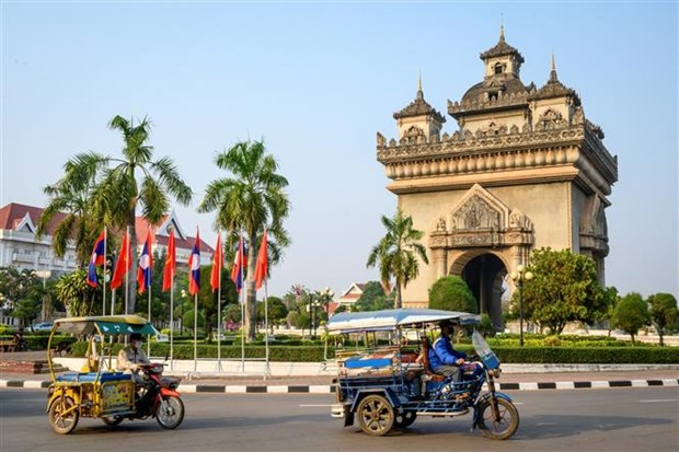 Laos imposes lockdown on Vientiane amid increasing COVID-19 cases hinh anh 1