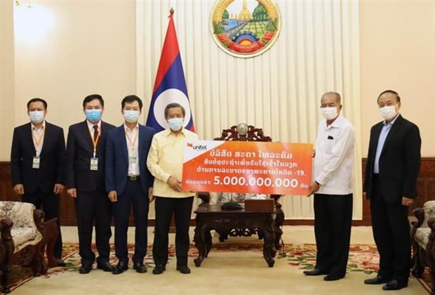 Vietnamese community in Laos joins hands in fighting COVID-19 hinh anh 1