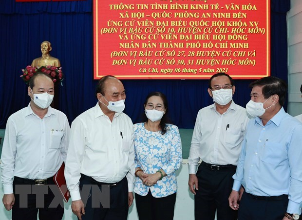 State President holds working session with Cu Chi, Hoc Mon districts in HCM City hinh anh 1