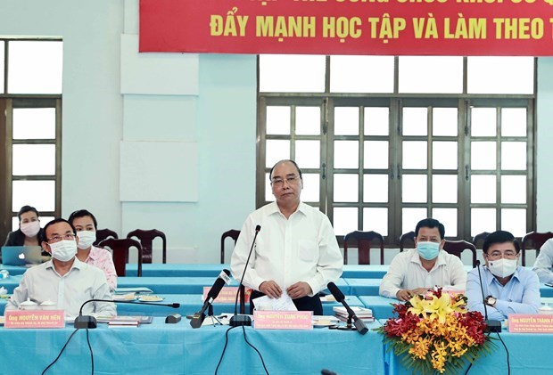 State President holds working session with Cu Chi, Hoc Mon districts in HCM City hinh anh 2