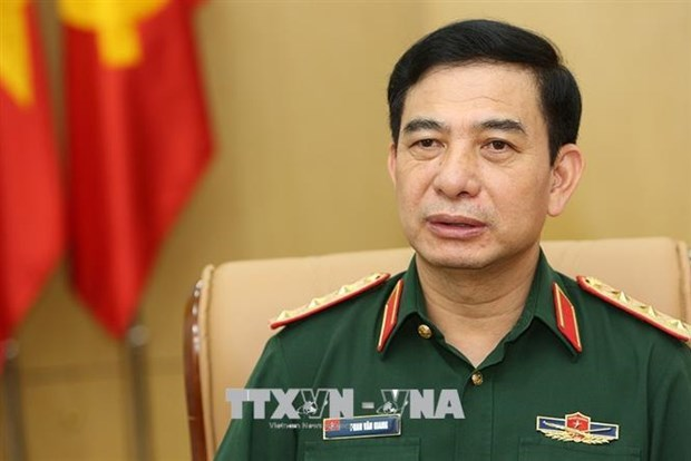 Vietnamese, Lao defence chiefs hold online talks hinh anh 1