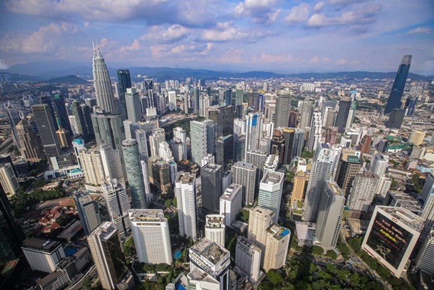 Malaysian central bank keeps growth forecast at 6 - 7.5 percent for 2021 hinh anh 1