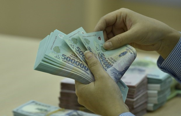 Reference exchange rate down 17 VND hinh anh 1