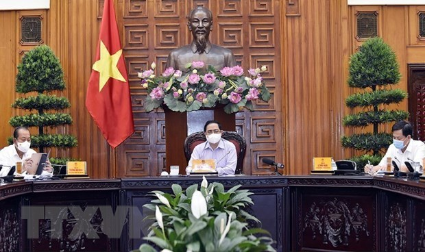 PM calls for further vigilance against COVID-19 hinh anh 1
