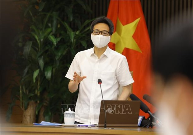 Deputy PM stresses prevention of COVID-19 transmission in IPs hinh anh 2