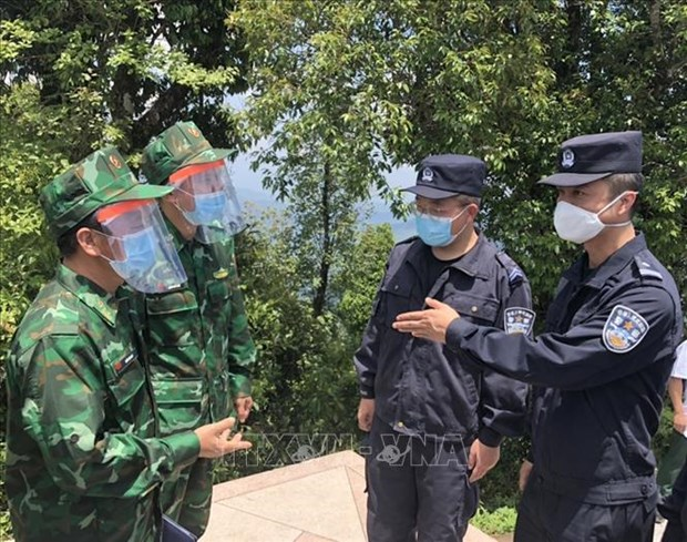 Border guard forces of Vietnam, China, Laos meet to boost coordination hinh anh 2