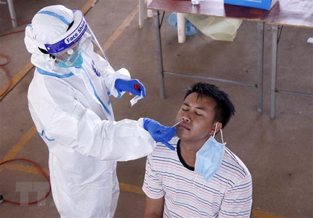 Laos, Cambodia record more new COVID-19 infections hinh anh 1
